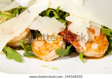 arugula dish with shrimp in a restaurant
