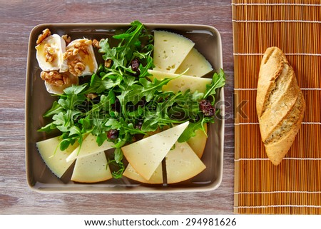 Arugula mediterranean salad with goat cheese honey and nuts - stock photo