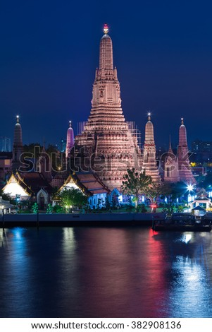 Arun temple at twilight, the most famous tourist destination in Bangkok Thailand - stock photo