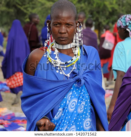 ARUSHA, TANZANIA - MAY 22: Masai woman tribe in Africa ethnic market with traditional jewellery, Arusha on May 22, 2013 - stock photo