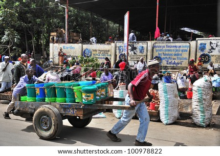 ARUSHA, TANZANIA - NOVEMBER 25: Native people made affairs near main road on November 25, 2011 in Arusha, Tanzania. Arusha is a city in northern Tanzania. It is the capital of the Arusha Region. - stock photo