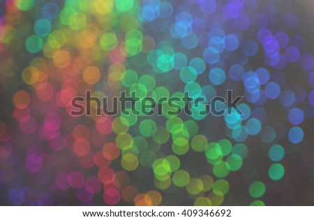 As in a dream. Blur vision of many blurry dots with bokeh effect of many colors