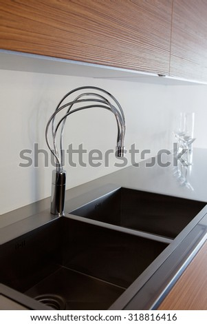 as modern shape and design sink in a kitchen close up in a showroom - stock photo