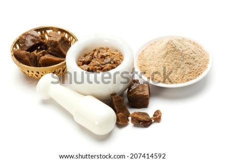 Asafoetida cake and powder - stock photo