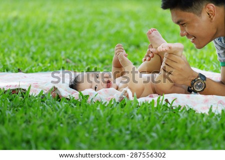 Asain family, asian baby girl was playing with her brother, they laughed happily. - stock photo