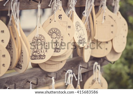 ASAKUSA, JAPAN - APRIL 24:The written wishes wooden plate of Senso-ji temple which dedicated from Tourist Organization of Japan and partners to the shrine on April 24, 2016 in Asakusa, Japan. - stock photo