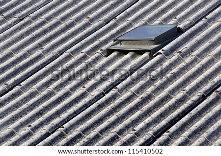Asbestos roof of a old house - stock photo