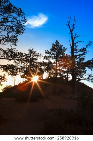 Ascending Sun in the Very Early Morning at Sunrise Point of Bryce Canyon National Park in Utah, United States Of America. Vertical Image Orientation - stock photo
