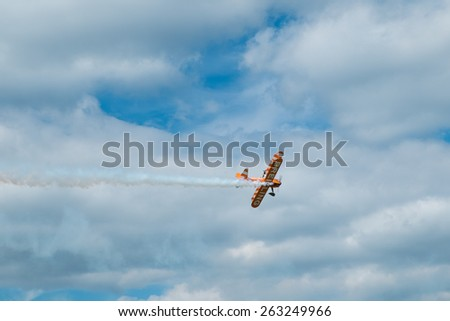 ASCOT, UK - AUGUST 16, 2014: Wing walking display at the Red Bull Air Race in Ascot, August 16, 2014. - stock photo