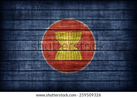ASEAN Economic Community flag pattern on wooden board texture ,retro vintage style - stock photo