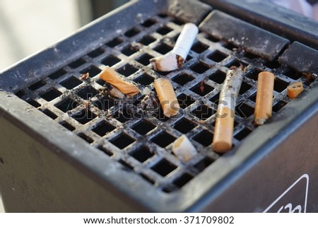 Ash tray filled with cigarettes