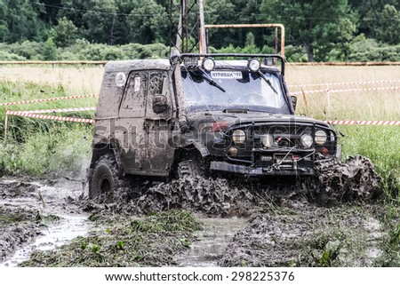 ASHA, RUSSIA - JULY 18, 2015: Off-road vehicle UAZ 3151 at the dirt road.