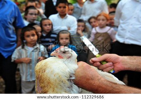 "ASHDOD - SEPTEMBER 15 : Jewish children look at ""Kaparot"" ceremony held on September 15 2010 in Ashdod Israel. - stock photo"