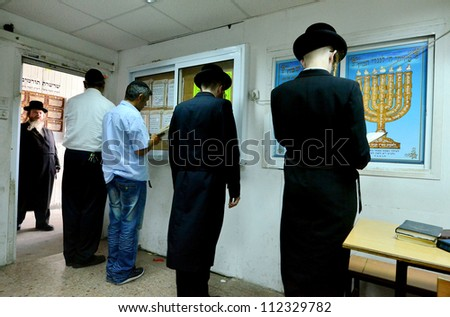 ASHDOD - SEPTEMBER 15 : Ultra orthodox Jewish men pray in a synagogue before Yom Kippur on September 15 2010 in Ashdod Israel. - stock photo