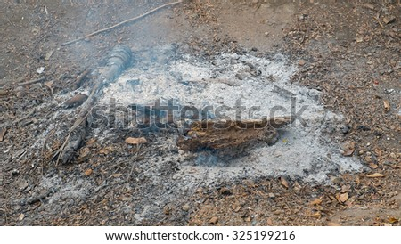 ashes on a burned fire place on ground