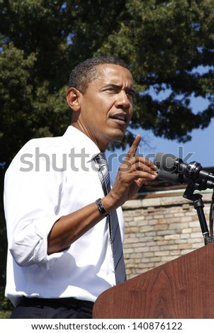 ASHEVILLE, NC - OCT. 5: Presidential candidate Barack Obama speaking at a podium during a campaign rally at Asheville High School on October 5, 2008. - stock photo