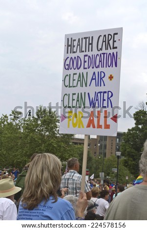 Asheville, North Carolina, USA - August 4, 2014: Moral Monday rally sign demanding health care, good education, clean air and clean water for all on August 4, 2014 in downtown Asheville, NC  - stock photo