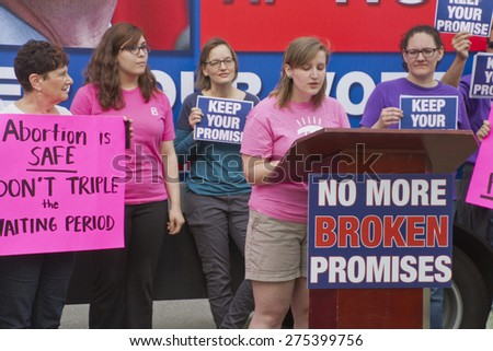 Asheville, North Carolina, USA - May 4, 2015:  Crowd holds signs asking NC Governor McCrory to keep his promise to not further restrict access to abortion at a rally protesting NC abortion bill #465 - stock photo