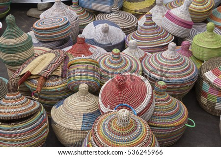 Asheville, North Carolina, USA - September 10, 2016: A variety of colorfully woven,  intricate and artistic baskets for sale at an African-Caribbean Goombay festival in downtown Asheville