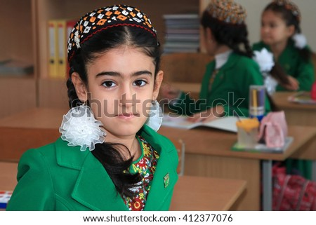 Ashgabad, Turkmenistan - November 4, 2014. Portrait of an unknown schoolgirl in the classroom.  November 4, 2014.  In schools of Turkmenistan annually trains about 900 thousand children. - stock photo