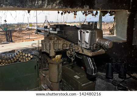 ASHKELON, ISR - DEC 19:Machine gun pointing towards Gaza Strip barrier on Dec 19 2005.The fence has kept Palestinians inside Gaza but has not stopped rockets being fired by militants into Israel.