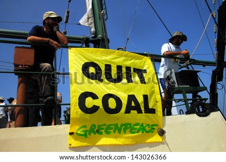 ASHKELON, ISR - SEP 03: Greenpeace activists on the Rainbow Warrior protesting on Sep 08, 2008. against Israel's plan to build a new electricity power plant  fueled by coal in Ashkelon, Israel.