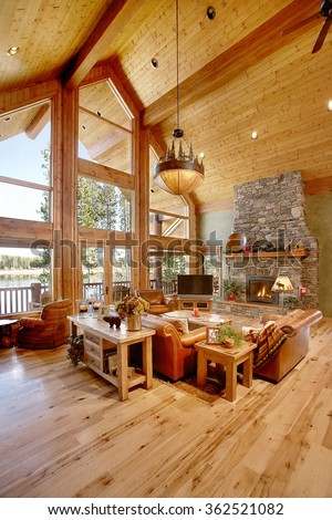 Ashton, Idaho, USA Oct. 30, 2009 The great room in a rustic log cabin, with with a stone fireplace, and rustic western decor. - stock photo