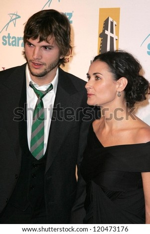 Ashton Kutcher and Demi Moore at the Hollywood Film Festival's 10th Annual Hollywood Awards Gala. Beverly Hilton Hotel, Beverly Hills, CA. 10-23-06 - stock photo