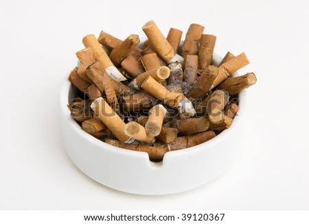Ashtray full of cigarettes isolated on white - stock photo