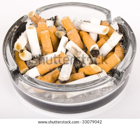 ashtray with   cigarette butts - stock photo