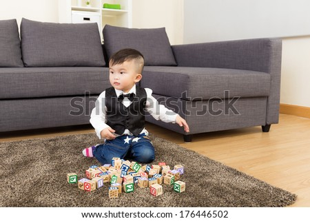 Asia baby boy play toy block at home - stock photo