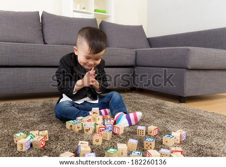 Asia baby boy play with toy block at home - stock photo