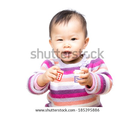 Asia baby girl play toy block and isolated