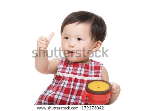 Asia baby girl with snack box and thumb up - stock photo