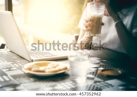 asia beuatiful woman Using Laptop In Coffee Shop - stock photo