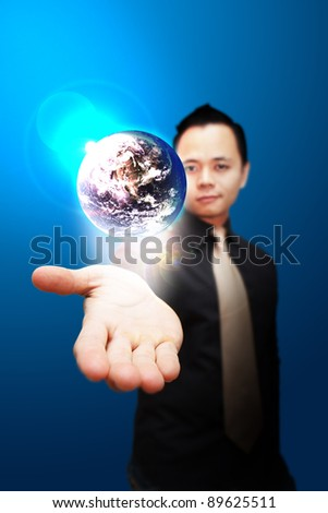 Asia Business man Hold the shining Earth on the hand