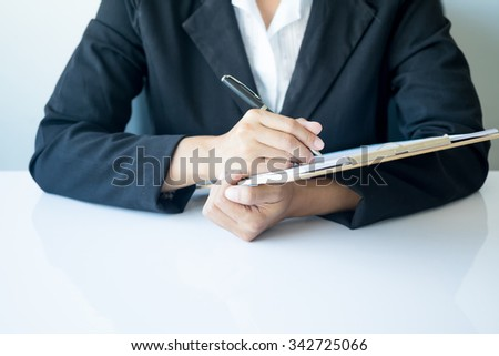 Asia business woman analyzing investment charts on desk.vintage tone Retro filter effect,soft focus,low light.(selective focus) - stock photo