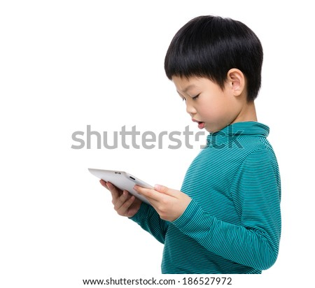 Asia child reading on tablet - stock photo