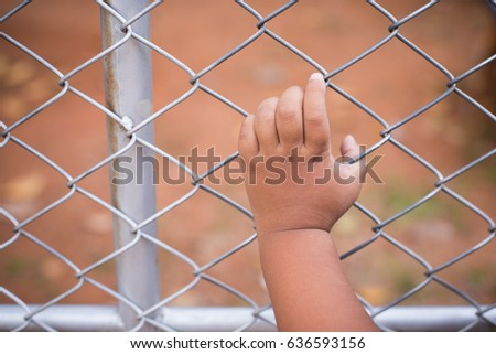 Asia children hand with steel cage