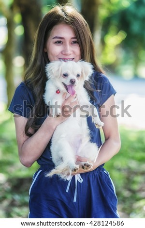 Asia Happy young woman with dog - stock photo