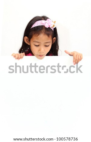asia little girl holding a blank white card. - stock photo