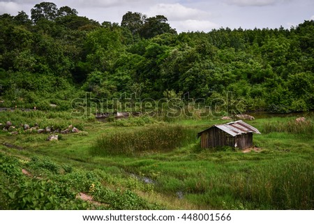 Asia old farm house in field - stock photo