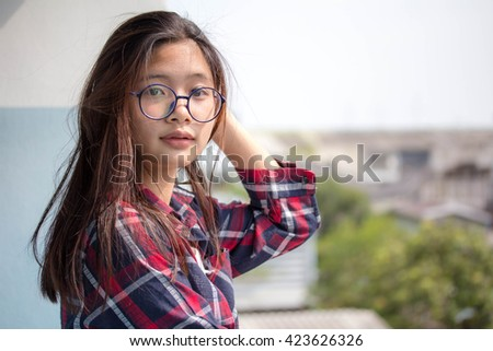 asia thai teenager Women Scotch T-Shirt Writing relax and smile - stock photo
