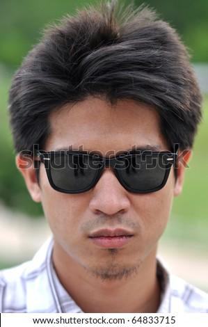 Asia Thailand Man Face Sunglasses - stock photo