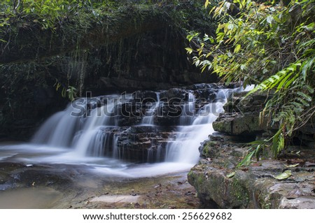 Asia waterfall called Batu Hampar waterfall in the tropical rain forest - stock photo