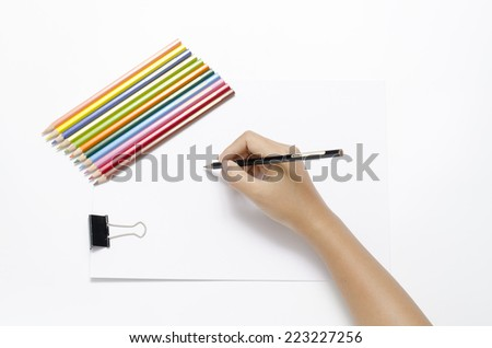 asia woman right hand with black pencil and left hand with colorful pencil on blank white paper over white background - stock photo