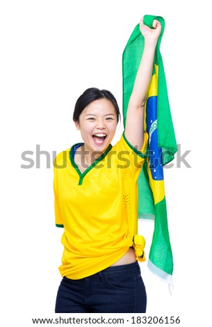 Asia woman with yellow football clothes and holding up Brazil flag