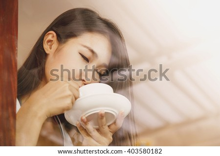 Asia women drinking coffee in coffee cafe. feel relaxed