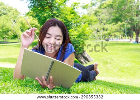 Asia Women Reading Book In Park