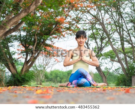 Asia Young woman doing yoga in morning park